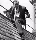 Stanley Baker in the rooftop chase climax scene